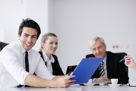 business people  team  at a meeting in a light and modern office environment. Stock Photo - 12565197