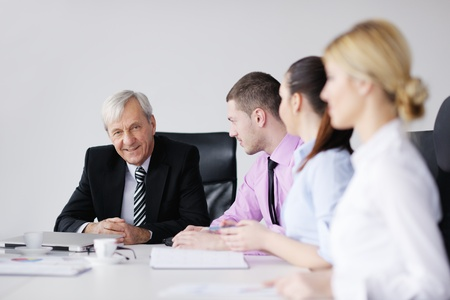 business people  team  at a meeting in a light and modern office environment. Stock Photo - 12565206