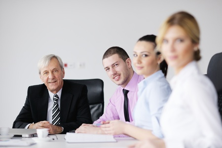 business people  team  at a meeting in a light and modern office environment. Stock Photo - 12565195