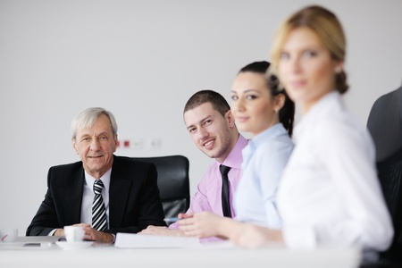 business people  team  at a meeting in a light and modern office environment. Stock Photo - 12565208