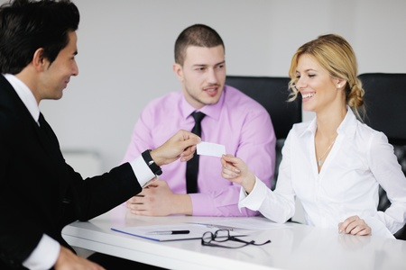 Group of young business people sitting in board room during meeting and discussing with paperwork Stock Photo - 12565179