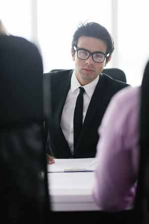 Confident young business man attending a meeting with his colleagues Stock Photo - 12565234