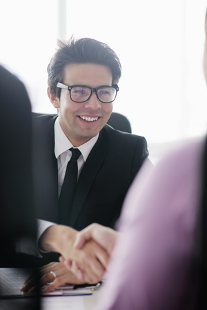 Confident young business man attending a meeting with his colleagues Stock Photo - 12565236