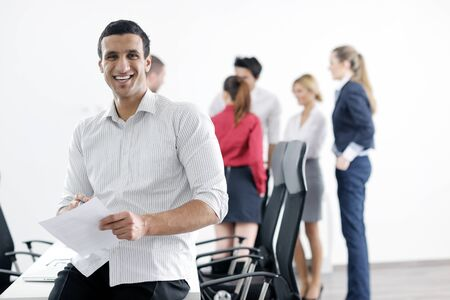 Confident young business man attending a meeting with his colleagues Stock Photo - 12565176