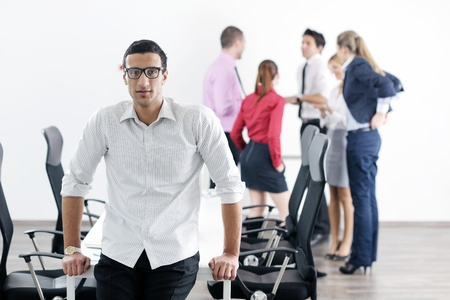 Confident young business man attending a meeting with his colleagues Stock Photo - 12565162