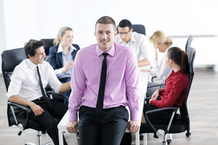 Confident young business man attending a meeting with his colleagues Stock Photo - 12565185