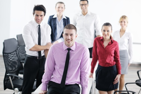 Confident young business man attending a meeting with his colleagues Stock Photo - 12565239