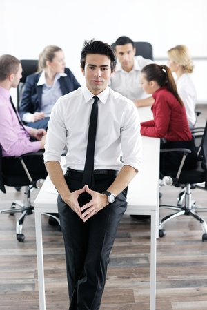 Confident young business man attending a meeting with his colleagues Stock Photo - 12565154