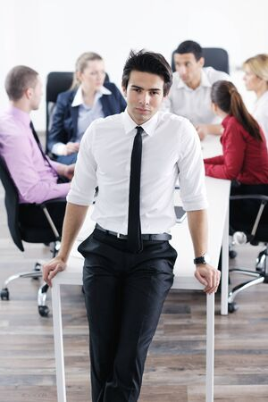 Confident young business man attending a meeting with his colleagues Stock Photo - 12565167