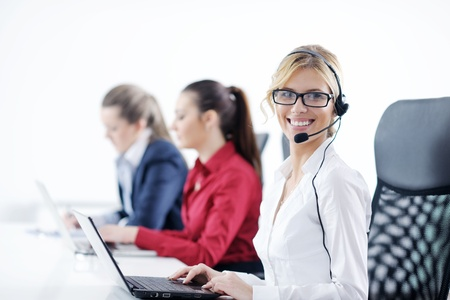 Pretty young business woman group with headphones smiling at you against white background Stock Photo - 12565218