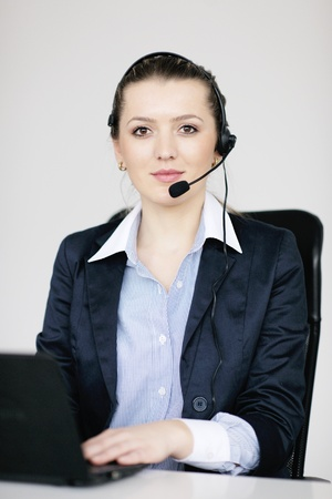 Pretty young business woman group with headphones smiling at you against white background Stock Photo - 12565158