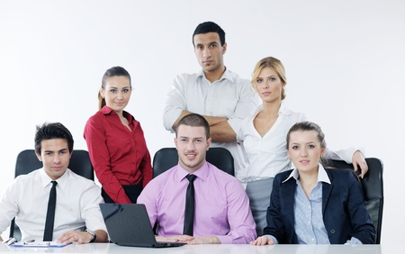 Group of young business people sitting in board room during meeting and discussing with paperwork Stock Photo - 12565187