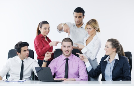 Group of young business people sitting in board room during meeting and discussing with paperwork Stock Photo - 12565188