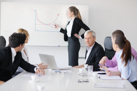 office environment: business people  team  at a meeting in a light and modern office environment.