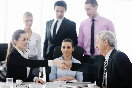 business people  team  at a meeting in a light and modern office environment. Stock Photo - 12567935