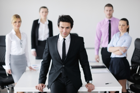 Confident young business man attending a meeting with his colleagues Stock Photo - 12567959