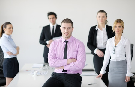 Confident young business man attending a meeting with his colleagues Stock Photo - 12567750