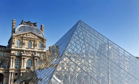 the pyramids: france louvre history  museum in paris at day and clear sky