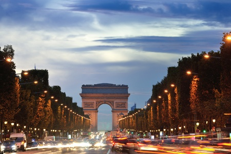 paris at night: Beautiful night view with car traffic and rush at eavning of the Arc de Triomphe, Paris, France. Editorial