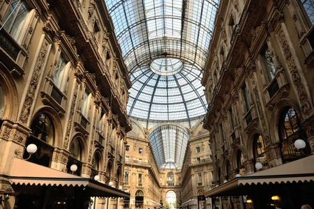 Symmetrical day shot of the hall of the landmark arcade or covered luxury shopping mall, Galleria Vittorio Emanuele II in Milan, Italy