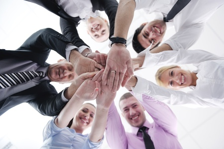 angle views: business people group joining hands and representing concept of friendship and teamwork,  low angle view