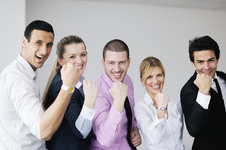 Group of young business people sitting in board room during meeting and discussing with paperwork Stock Photo - 12766272