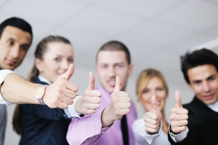Group of young business people sitting in board room during meeting and discussing with paperwork Stock Photo - 12764989