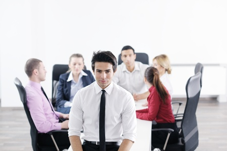Confident young business man attending a meeting with his colleagues Stock Photo - 12764982