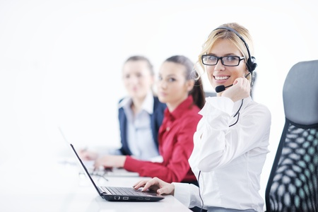 Pretty young business woman group with headphones smiling at you against white background photo