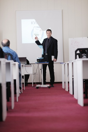 young business man giving presentation and education leassons on seminar event in small bright conference room Stock Photo - 13112316