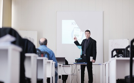 young business man giving presentation and education leassons on seminar event in small bright conference room photo