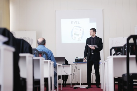 young business man giving presentation and education leassons on seminar event in small bright conference room Stock Photo - 13112306