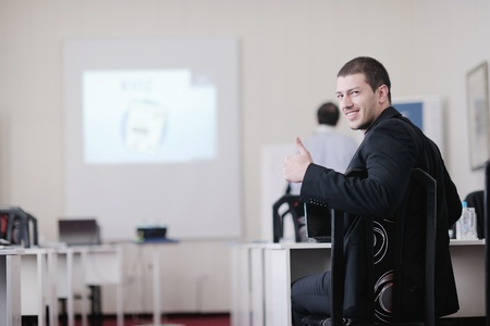 young business man giving presentation and education leassons on seminar event in small bright conference room Stock Photo - 13112301