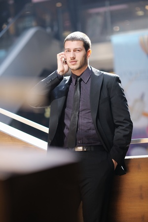 handsome young business man talking by cell phone outdoor photo