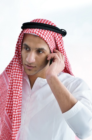 happy young arabic business man working at bright office photo