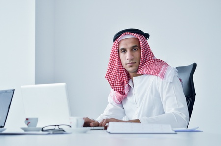 happy young arabic business man working at bright office Stock Photo - 12915155