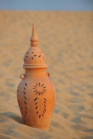 clay pot: antique art old arabic pot in sand