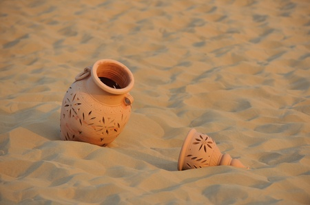antique art old arabic pot in sand photo