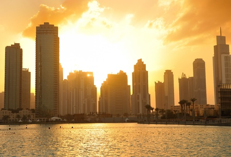 dubai city skyline at sunset conctruction and modern architecture concept photo
