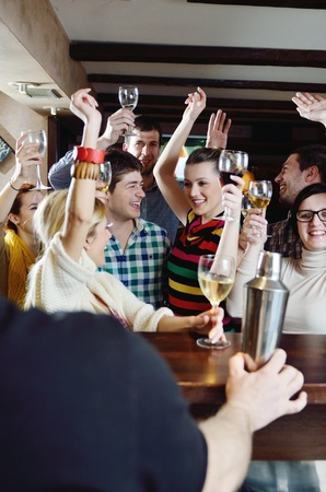 Group of happy young people drink wine  at party disco restaurant Stock Photo - 13112440