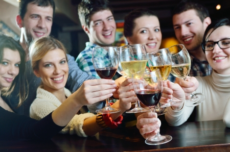 friends at bar: Group of happy young people drink wine  at party disco restaurant