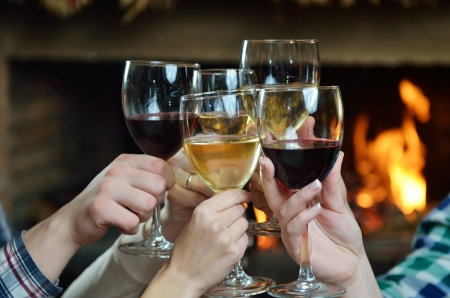 woman drinking wine: Group of happy young people drink wine  at party disco restaurant