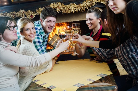 Group of happy young people drink wine  at party disco restaurant Stock Photo - 13112572