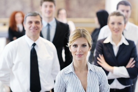 business woman standing with her staff in background at modern bright office conference room Stock Photo - 13112567