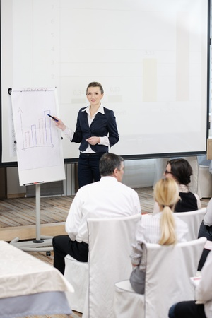 business people group at meeting seminar presentation in brigt conference room Stock Photo - 13112478