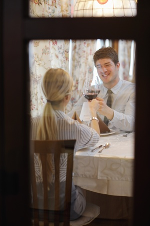 A young couple having romantic  dinner at a restaurant Stock Photo - 13179975