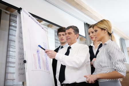 Senior male business man giving a presentation at a  meeting at modern light office on a table board Stock Photo - 13180579