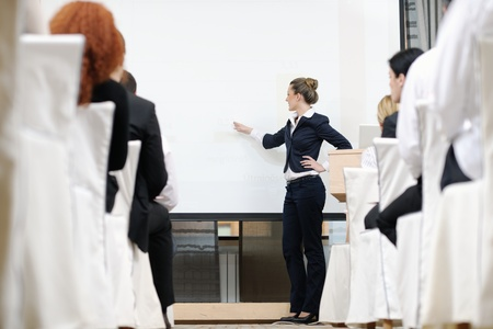 business people group at meeting seminar presentation in brigt conference room Stock Photo - 13276549