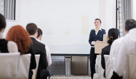 business people group at meeting seminar presentation in brigt conference room Stock Photo - 13276522