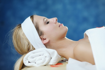 wellness center: Beautiful young woman in spaand wellness. Face back and  stone massage